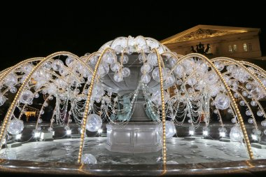 Electric fountain at night, lighted during christmas near the Bolshoi Theatre (Large, Great or Grand Theatre, also spelled Bolshoy), Moscow, Russia
