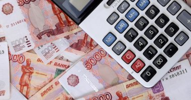 Close-up of russian banknotes (Five Thousand Ruble Notes) and calculator