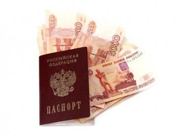 Close-up of russian banknotes (Five Thousand Ruble Notes) and passport of the Russian Federation