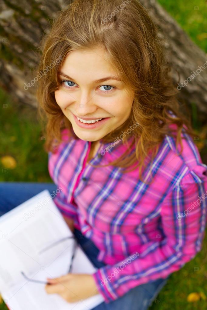 Pretty teen girl in park