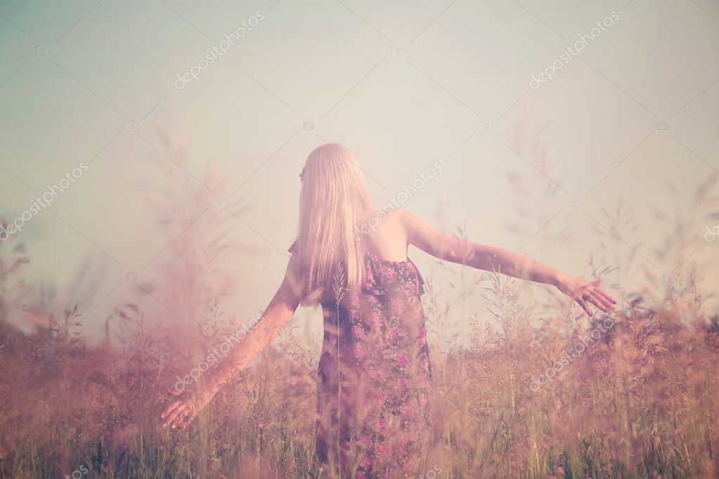 Girl having fun in summer field