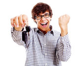 Happy student with car keys closeup