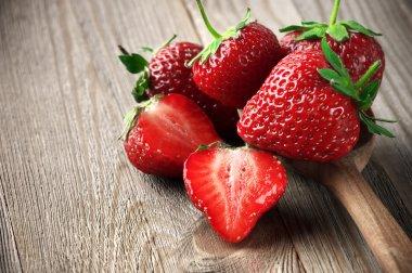 Strawberries on weathered wood