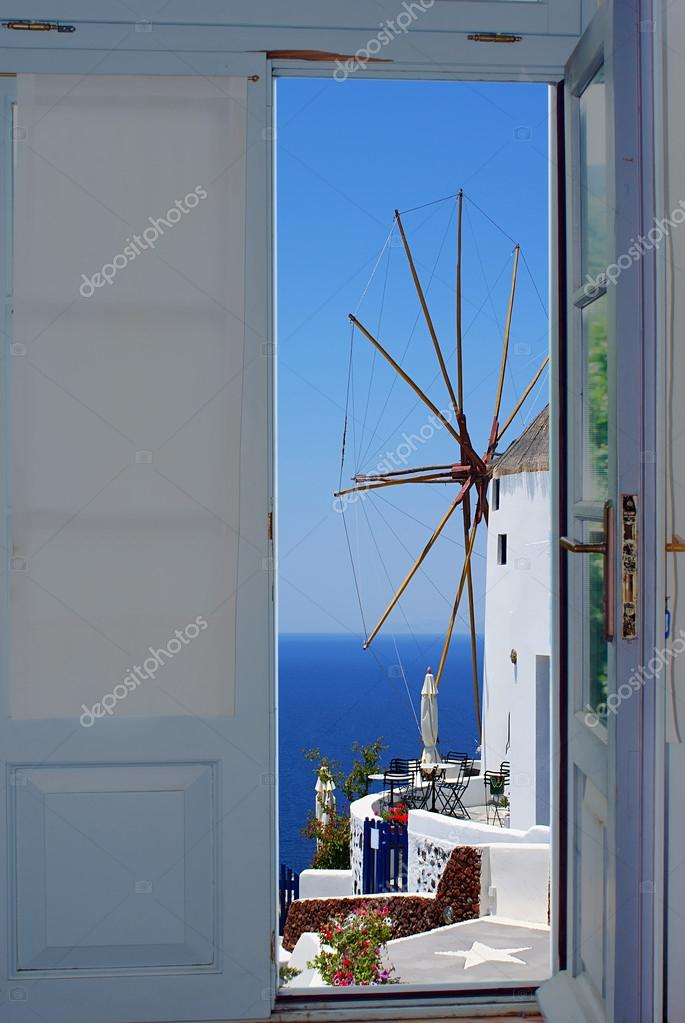 Balcony door with a great view on Santorini island, Greece