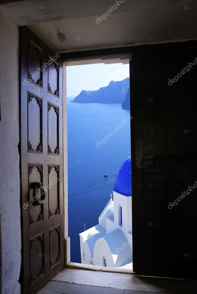 Old Byzantine door with a great view on Santorini island, Greece