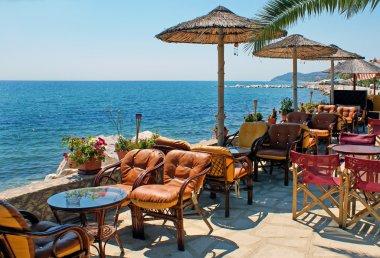 Beautiful cafeteria at the beach, on Santorini island, Greece
