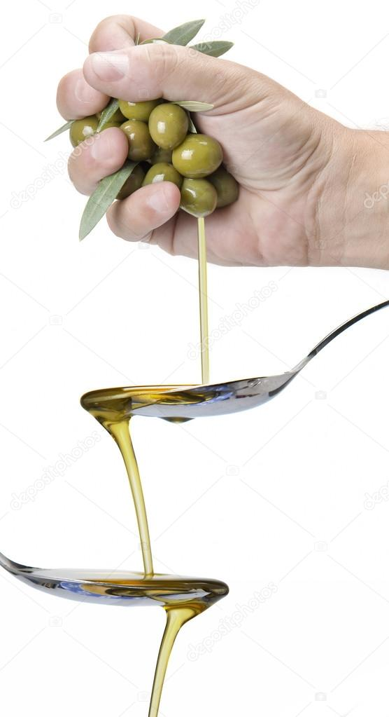 Handful of olives dropping
