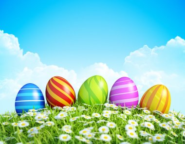 Easter Greeting Card Background with decorated Easter eggs on meadow.