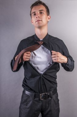 Young businessman pulls shirt