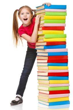 Schoolgirl holding pile of books. Isolated