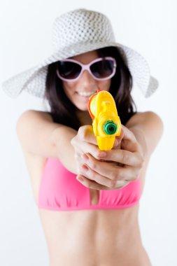bikini girl with squirt gun