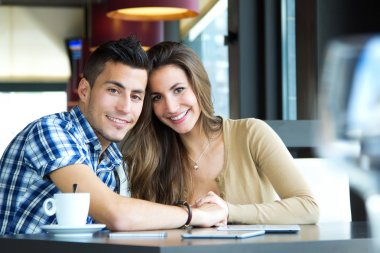 Portrait of young couple in love at a coffee shop stock vector