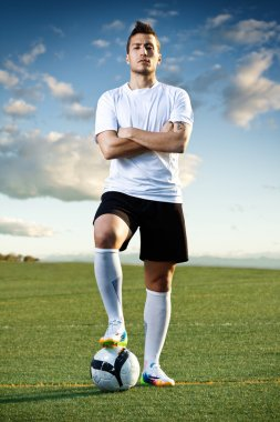 Soccer player with ball, outdoors
