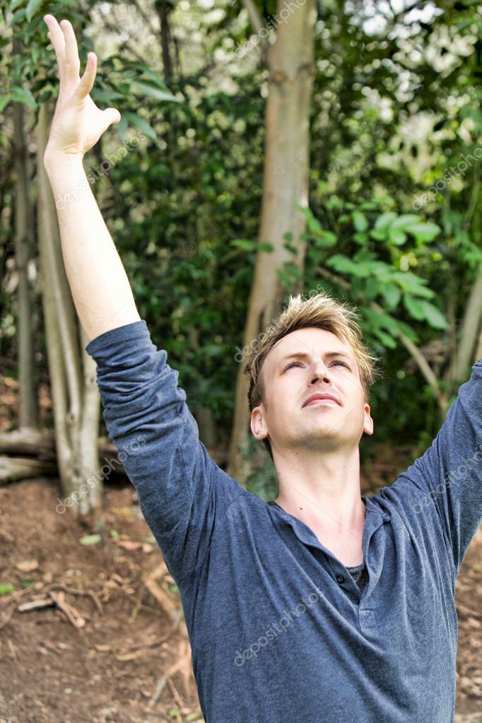 Man raises arms above his head
