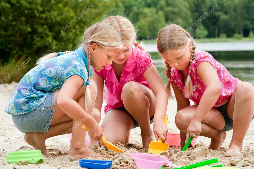 The girls digging in the sand