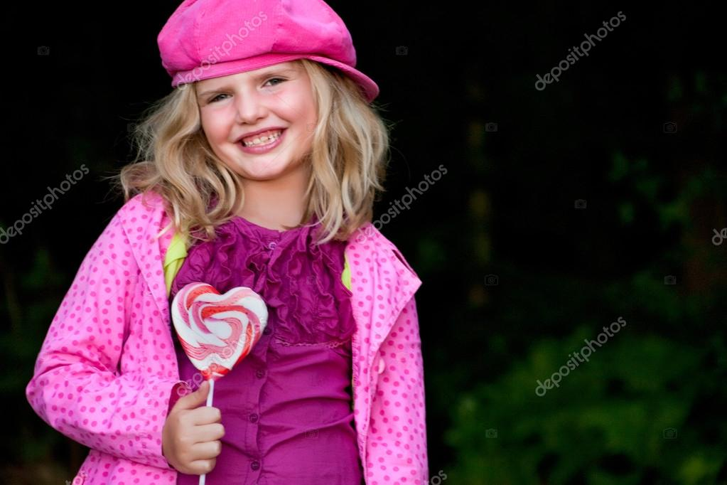 Smiling pink girl with lolli