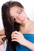Woman is looking at her hair