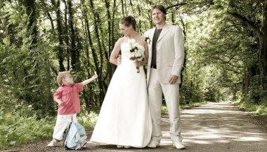 wedding couple and child
