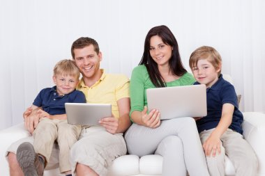 Happy family using laptop at home