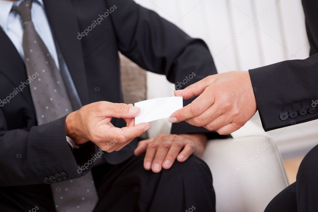 Business card being passed over