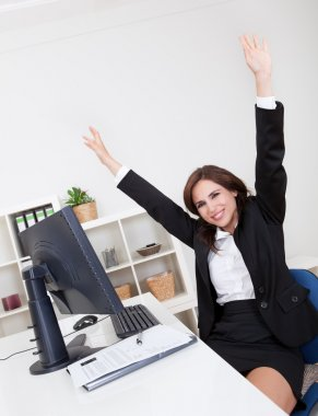 Businesswoman Cheering At Desk