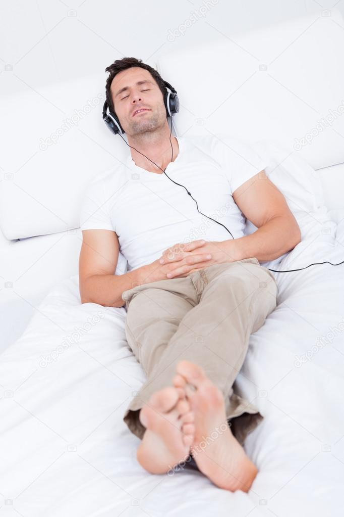 Young Man Listening Music On Headphone