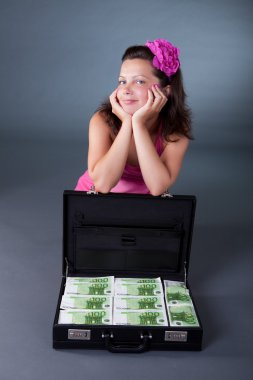 Woman with briefcase full of euros