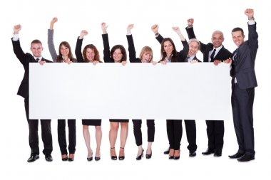 Group of business with a blank banner