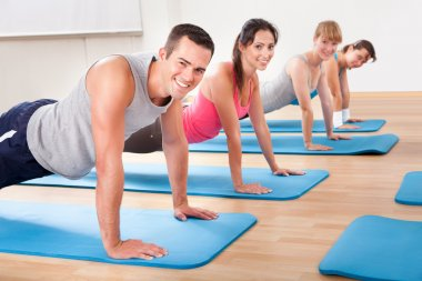 Gym class doing press ups