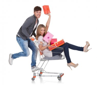 Woman carried by push cart