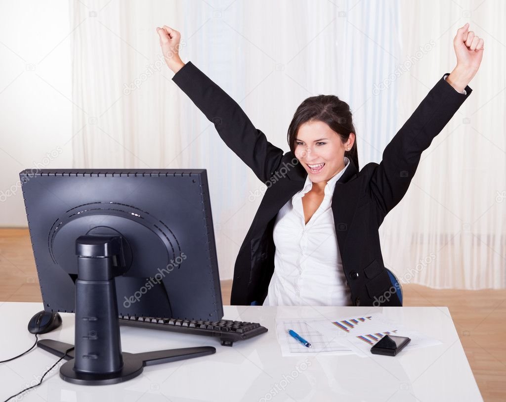 Successful businesswoman celebrating