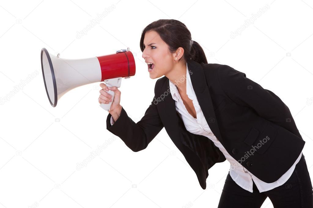 Woman shouts through a megaphone