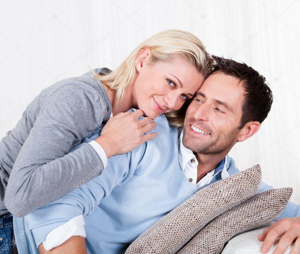 Free Hug Sofa Happy Man And Woman Cuddling Stock Photo 169 Andreypopov