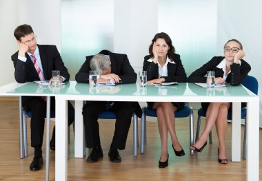 Bored panel of judges or interviewers