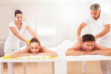 Masseurs giving back massages
