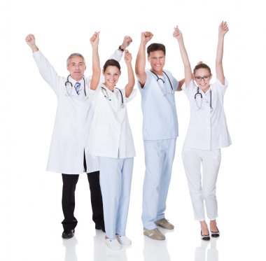 Diverse medical team of male and female doctors and nurses celebrating a successful outcome to a case stock vector