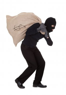 Thief carrying a large bag of money
