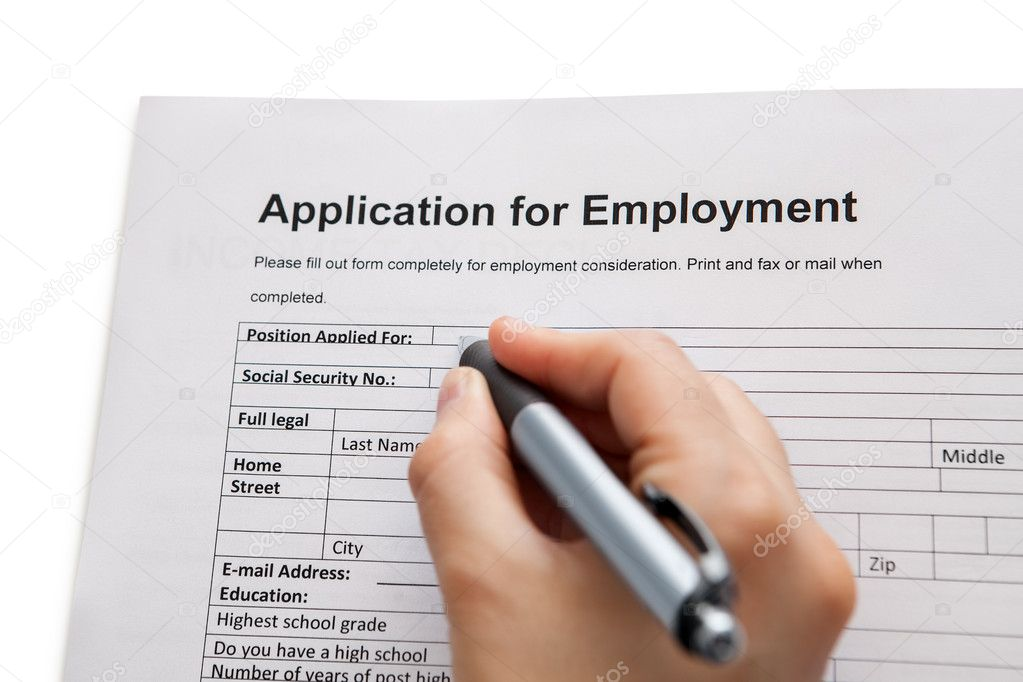 Male hand completing a job application