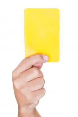 Soccer Referee Showing Yellow Card