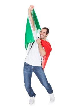 Portrait Of A Happy Man Holding An Italian Flag