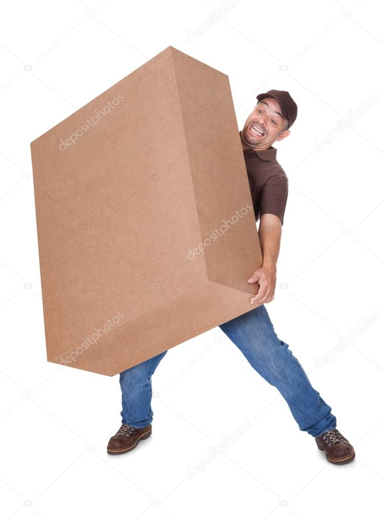 Delivery Man Carrying Heavy Box On White Background