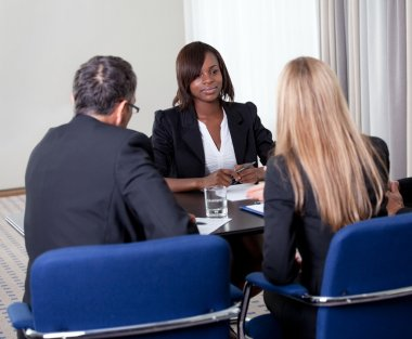Group of managers interviewing female candidate