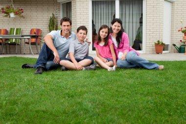 Caucasian family portrait sitting