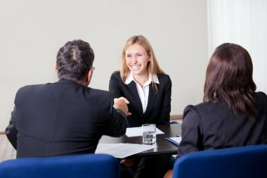 Female shaking hands at the job interview