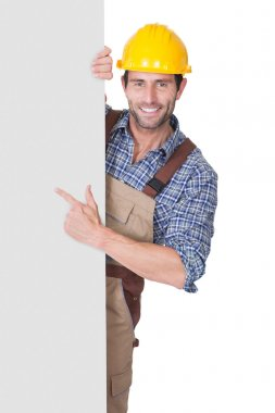 Construction worker presenting empty banner