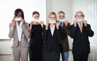 Group of business executives with sad emotions