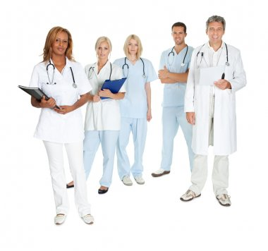 Happy team of doctors and surgeons on white