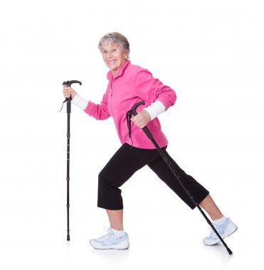 Senior Woman Walking With Hiking Poles