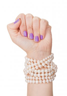 Close-up Of Woman's Hand Holding Pearl Necklace