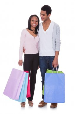 Young Couple With Shopping Bags